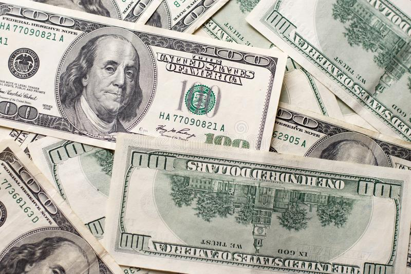 Donnez aux dollars US une consistance rugueuse de mpney Fond de cent billets d'un dollar images libres de droits