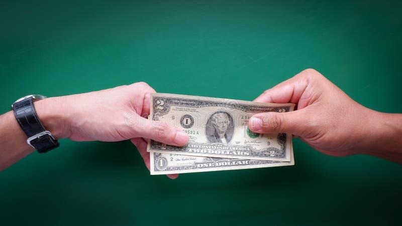 Donnez l'argent photographie stock