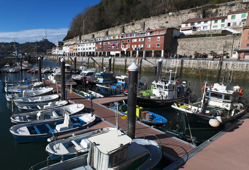 Donostia, San Sebastian, Bay of Biscay, Basque Country, Spain, Europe. Basque Country, Spain, 28/01/2017: boats in the port and view of the skyline on the royalty free stock photo