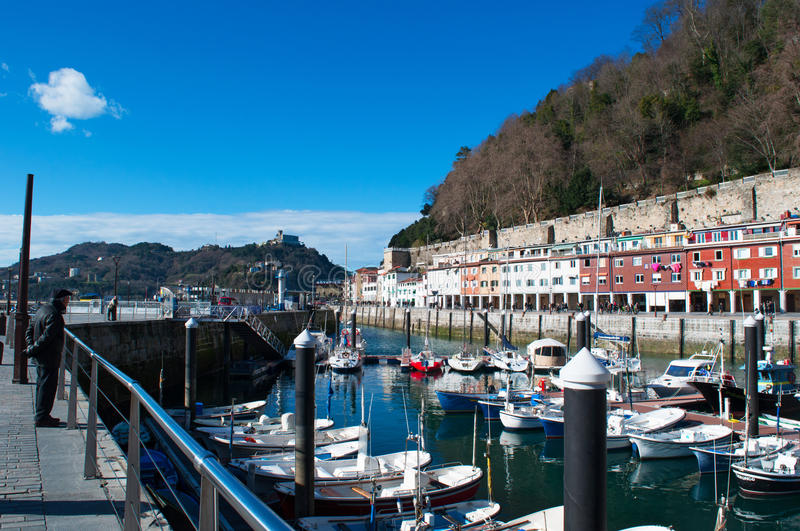The skylne of San Sebastian, Donostia, port, boats, Bay of Biscay, Basque Country, Spain, Europe. Basque Country, Spain, 28/01/2017: a man with the beret in the stock photos