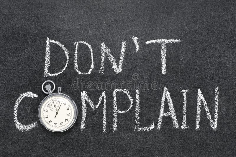 Do not complain. Dont complain phrase handwritten on chalkboard with vintage precise stopwatch used instead of O royalty free stock photo
