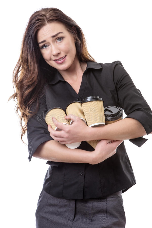 Dont drop them!. Close up shot of a pretty brunette business woman juggling some takeaway cups isolated on white royalty free stock photo