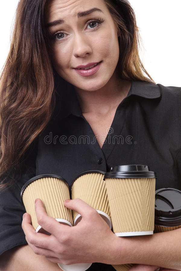 Dont drop them!. Close up shot of a pretty brunette business woman juggling some takeaway cups isolated on white stock image