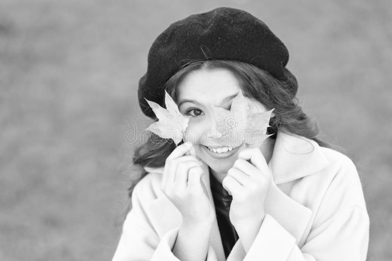 Dont give up being fashionable. Fashion trends for autumn. Small girl happy smiling with autumn leaves. Happy girl on stock photo