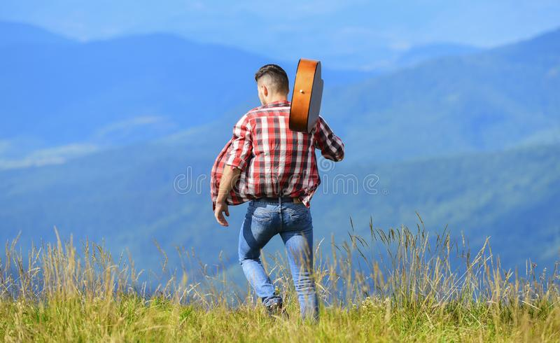 Dont look back. sexy man with guitar in checkered shirt. hipster fashion. western camping and hiking. happy and free stock photos