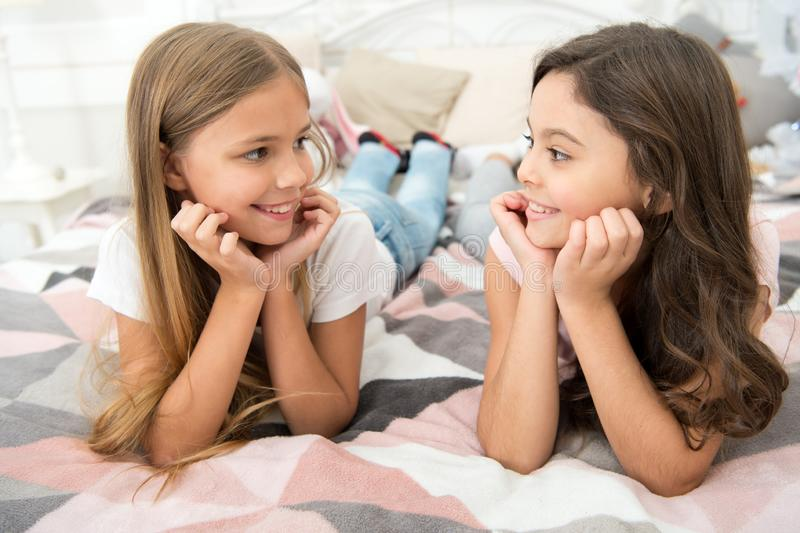 Dont stop smiling everyday. Happy children smiling. Smiling girls relax on bed. Childrens dentist. Kids dentistry. Dental clinic. Keep smiling stock photo