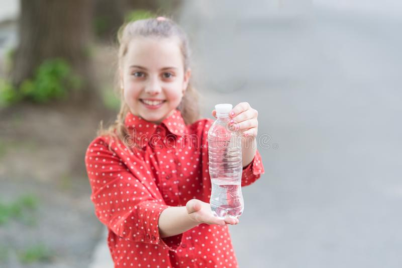 Dont wait, hydrate. Bottle of potable water selective focus. Little girl drinking water to quench thirst. Thirsty child. Thirst or dehydration. Thirst stock image