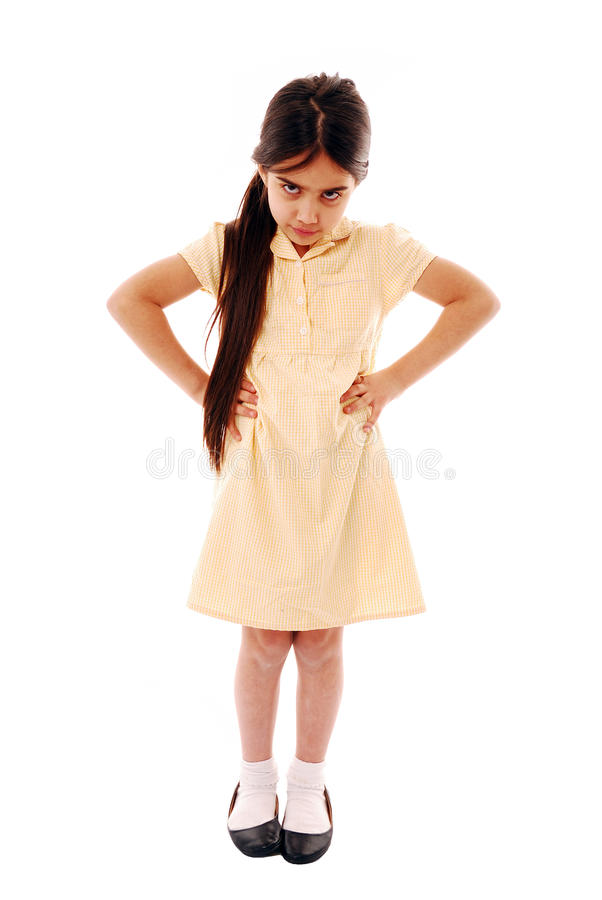 Dont want to go to school. Schoolgirl with hands on hips isolated on white stock images