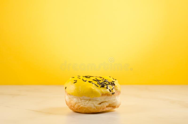 Donut. Assorted donut lying on a white table on yellow background. Ð¡oncept sweet food stock photos