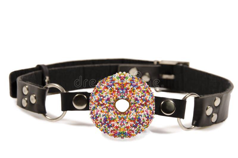 Donut ball gag. Isolated on white background stock photo