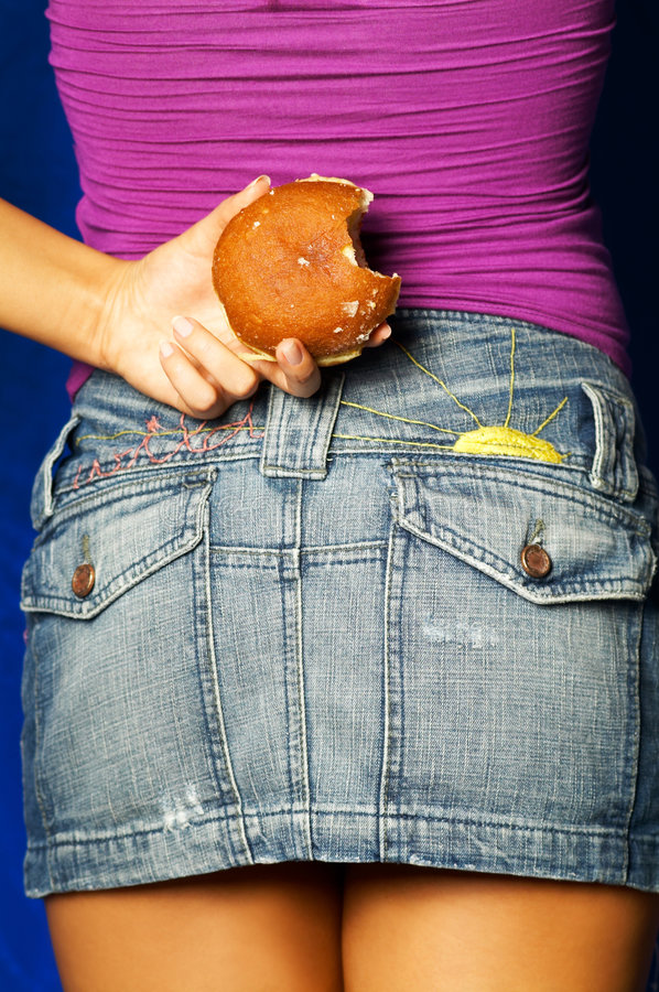 Donut Behind Back royalty free stock images