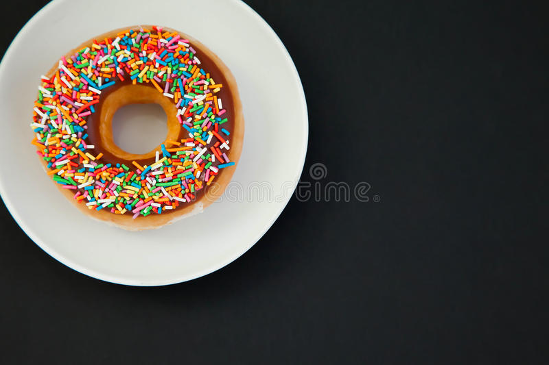 Donut on the black background stock photos
