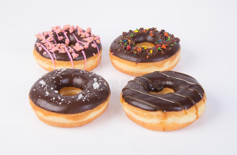 chocolate donuts on a white background stock images