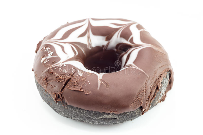 Donut. Chocolate donut with rough surface cream royalty free stock images