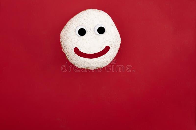 Donut con la faccia strana fotografie stock libere da diritti