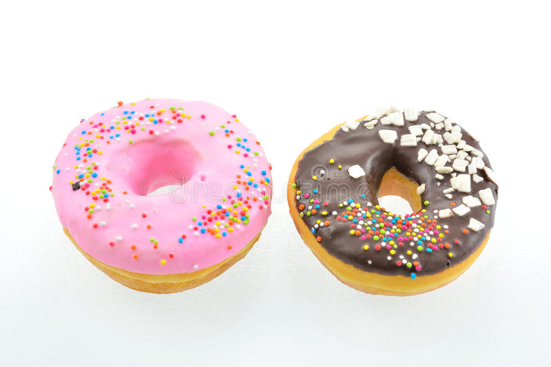 Donut. A doughnut or donut (/ˈdoʊnət/ or /ˈdoʊnʌt/; see spelling differences) is a type of fried dough confectionery or dessert food. The royalty free stock image