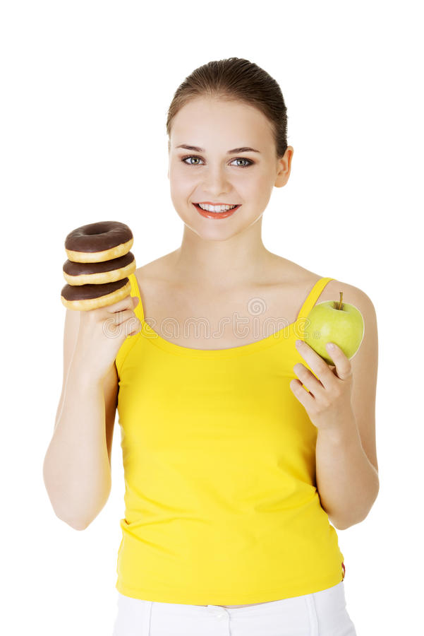 Donut or green apple - hard chose. royalty free stock image