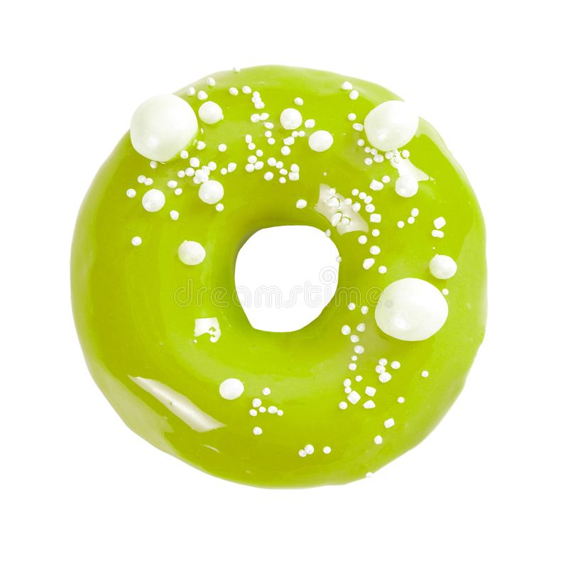 Donut with green glossy mirror glaze isolated on white. Background. Top view royalty free stock image