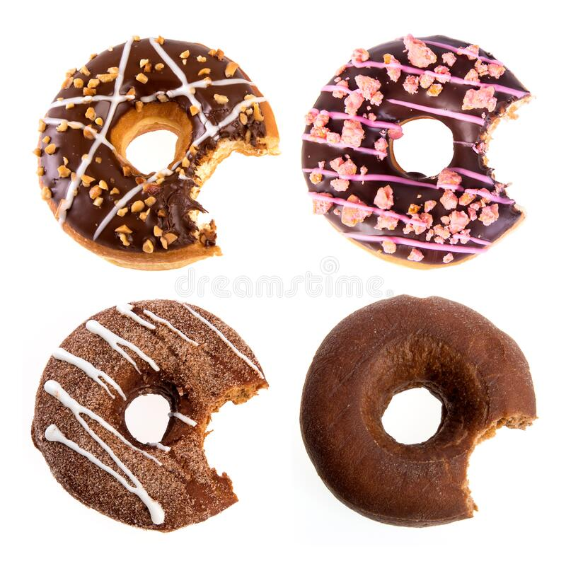 Donut or donut with missing bite on a background new royalty free stock photo