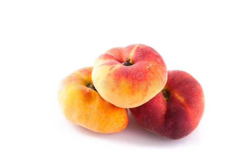 Donut peach. Also known as chinese flat peach or saucer peach stock photo