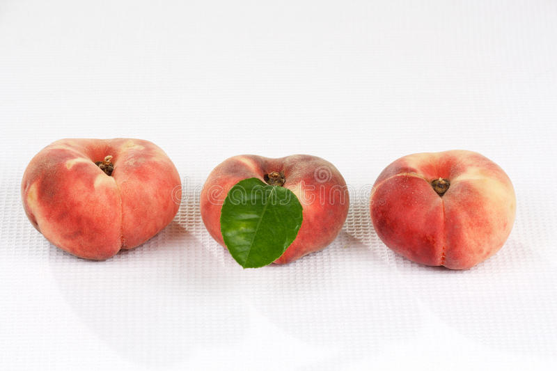 Donut peach exotic rare sweet fruit. Also known as chinese flat peach royalty free stock image