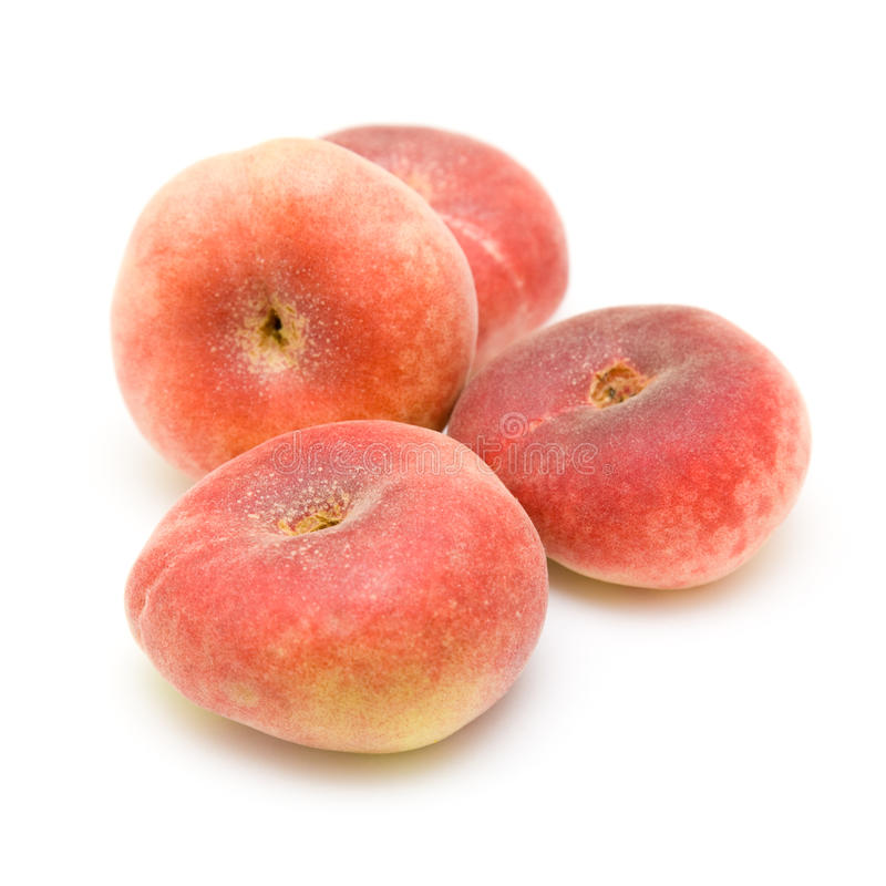 Donut peaches isolated on white. (Paraguayos, Saturn Peaches or Chinese Flat Peaches, Doughnut peaches stock photo