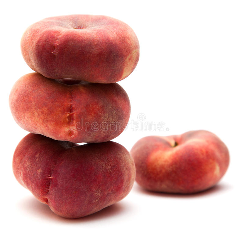 Donut peaches. Isolated on white (Paraguayos; Saturn Peaches; Chinese Flat Peaches; Doughnut peaches royalty free stock photos