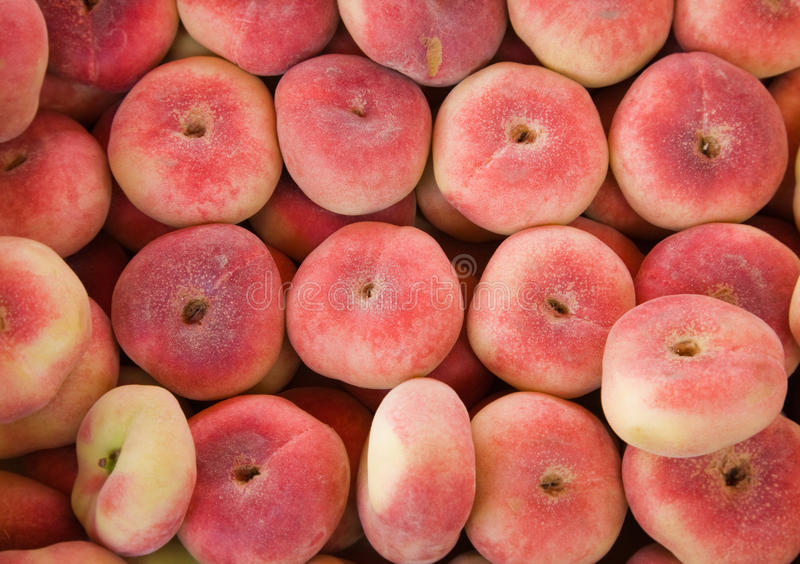 Donut peaches for sale. At a marketplace (Paraguayos; Saturn Peaches; Chinese Flat Peaches; Doughnut peaches royalty free stock photo