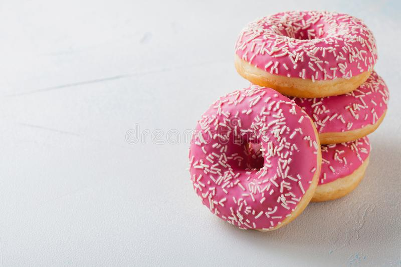Donut. Sweet icing sugar food. Dessert colorful snack.Treat from delicious pastry breakfast. Bakery cake. Doughnut with frosting. stock photography