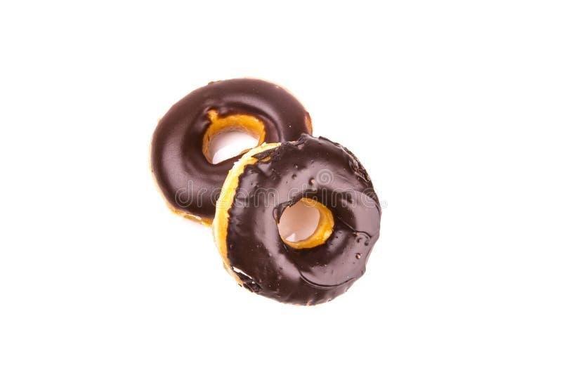 Donuts шоколада изолированные на белой предпосылке стоковые фотографии rf