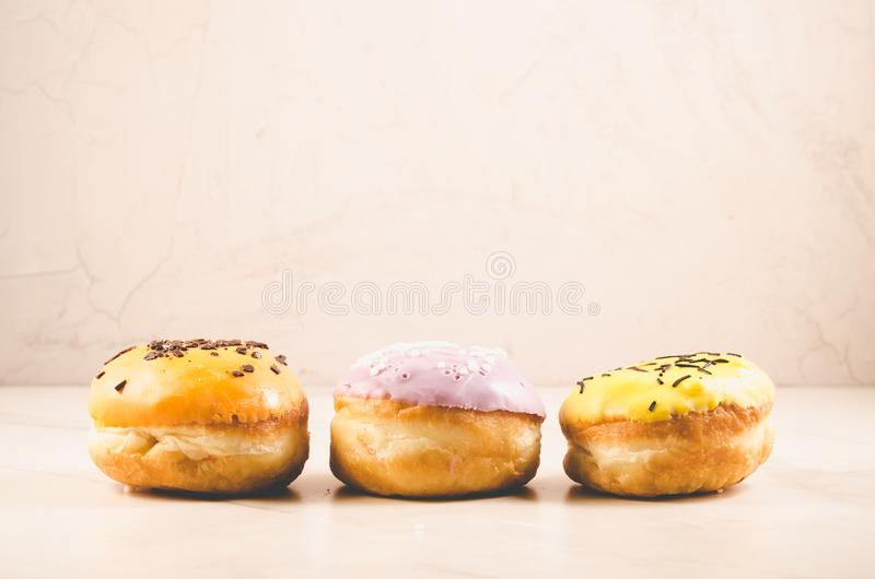 Donuts. Assorted donuts lying on a white table on white background. Ð¡oncept sweet food royalty free stock photo