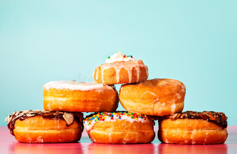 Donuts. Assorted donuts on pastel blue and pink background stock image