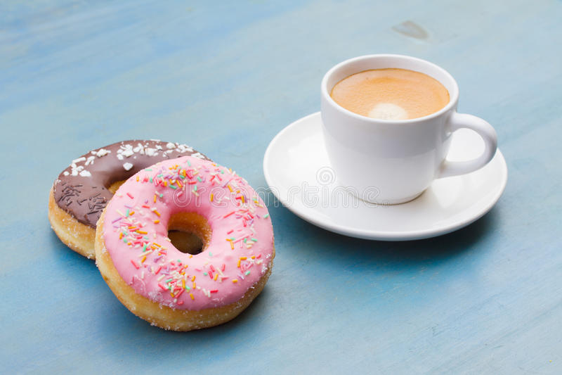 Donuts with black coffee stock photos