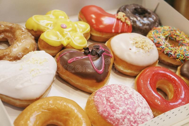 Donuts in the box. Assorted donuts in a box royalty free stock images