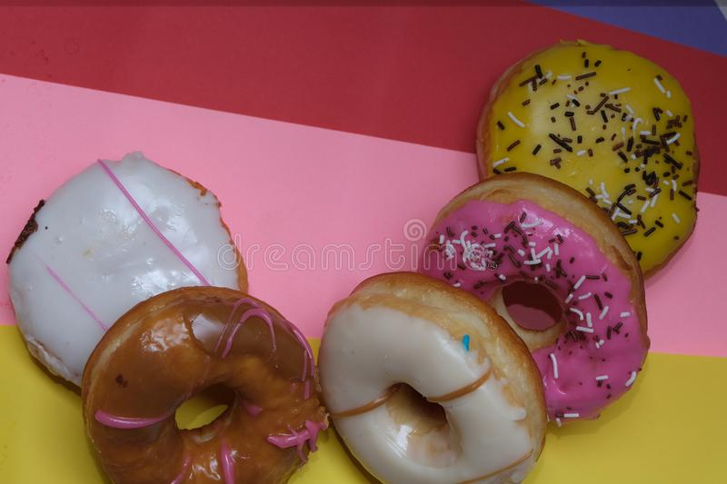 Donuts  on colorful background. Many Assorted donuts on a background stock photo