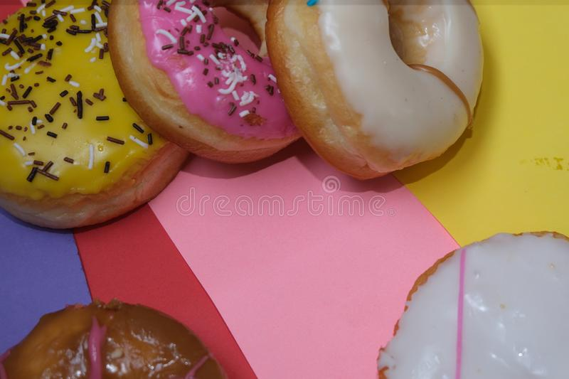 Donuts  on colorful background. Many Assorted donuts on a background royalty free stock images