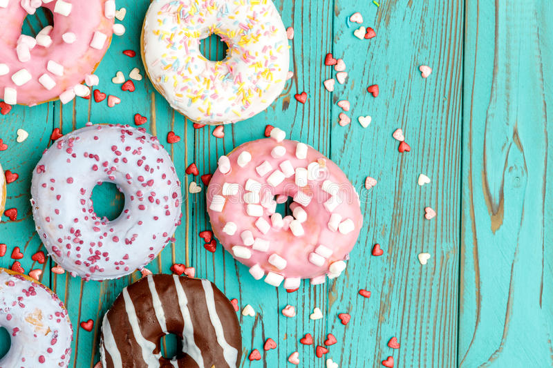 Donuts on colorful wooden background. Studio shot of tasty Donuts on colorful wooden background stock photo