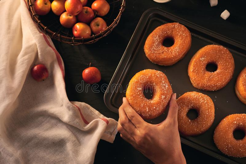 Donuts, fresh apples and dry autumn leaves, top view.  stock photos