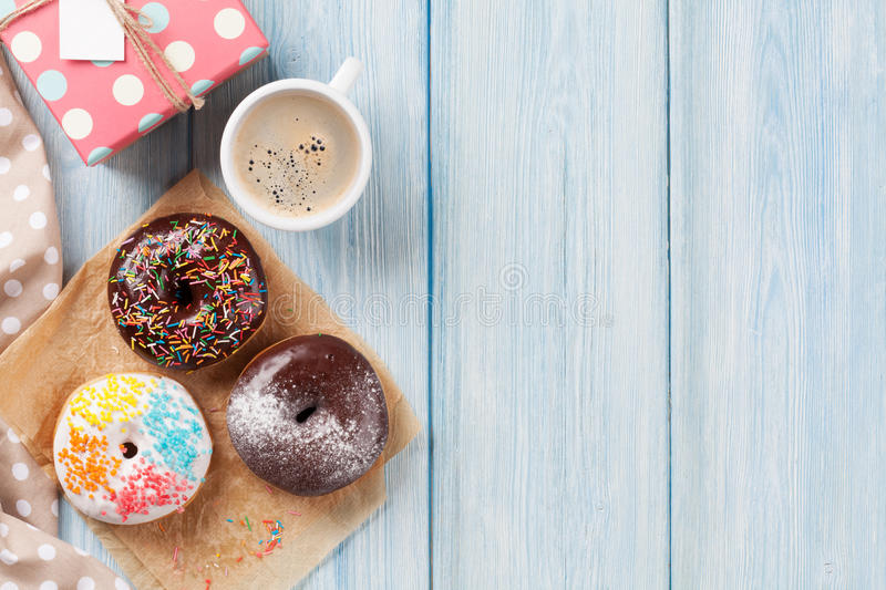 Donuts, gift box and coffee stock photos