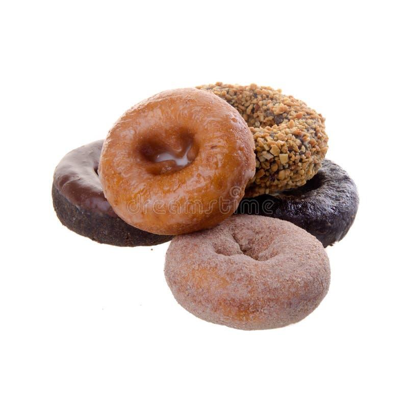 Donuts heerlijke en zoete donuts op achtergrond stock foto's
