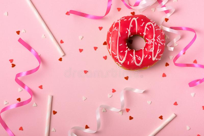 Donuts with icing on pastel pink background with copyspace. Sweet donuts. stock photos