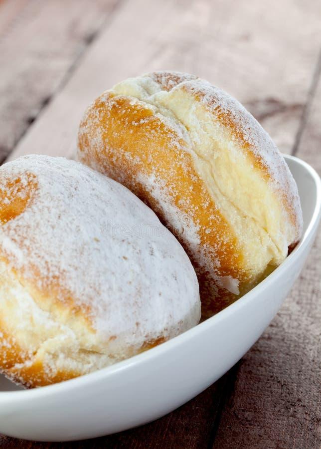 Donuts in kom stock afbeelding