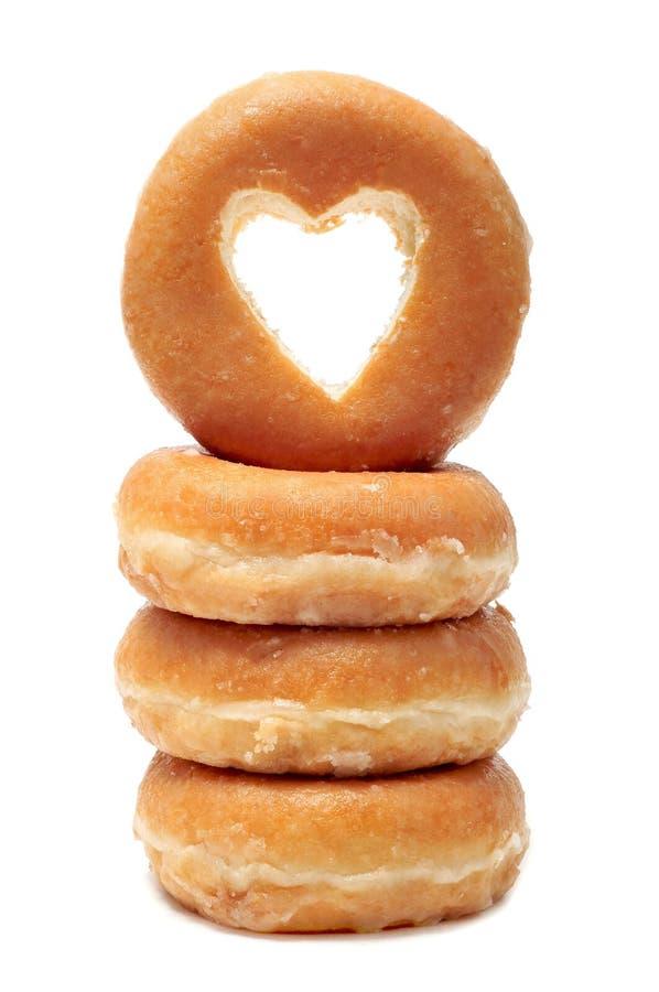 Donuts med ett hjärta format hål arkivfoto