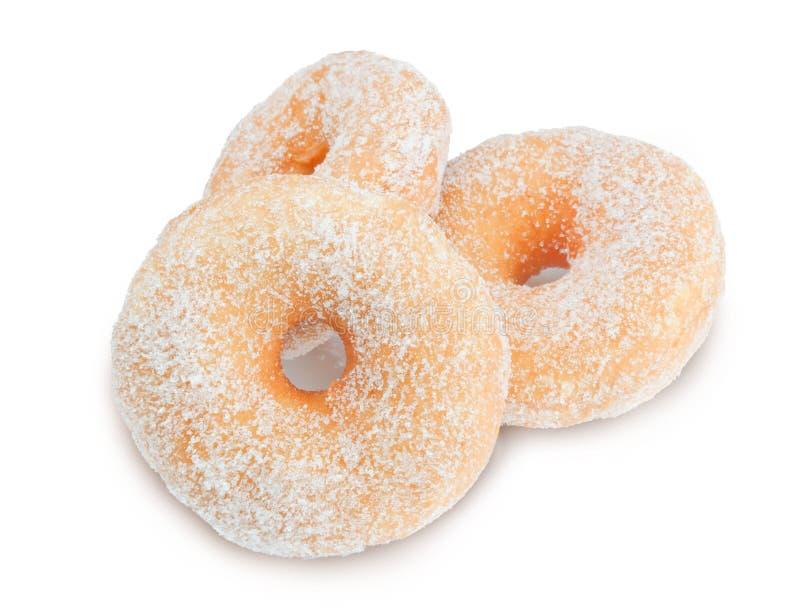 Donuts met suiker op witte achtergrond royalty-vrije stock foto's