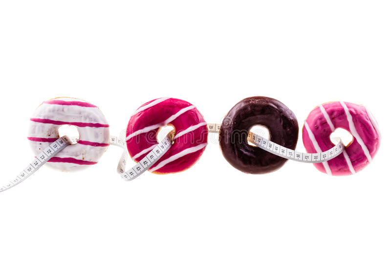 Donuts and meter royalty free stock photography