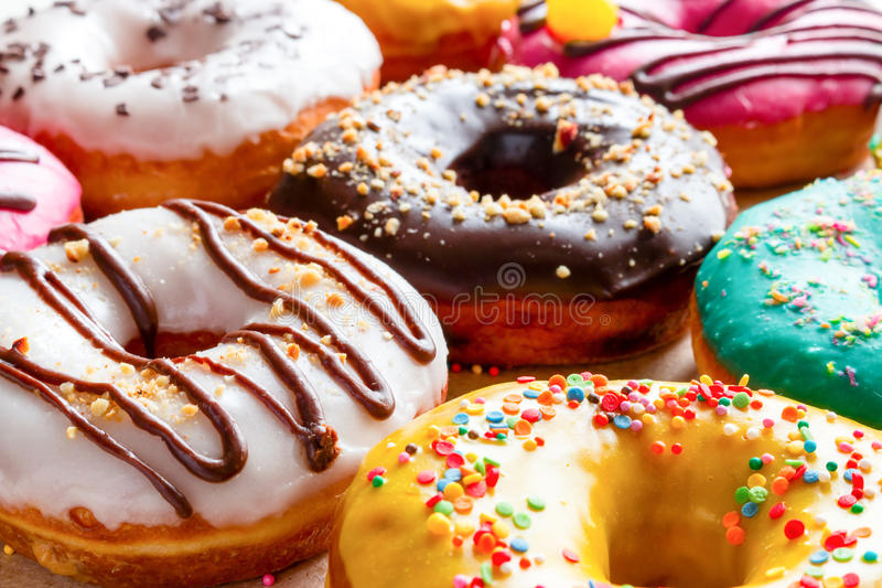 Donuts in multicolored glaze. Close-up stock photography