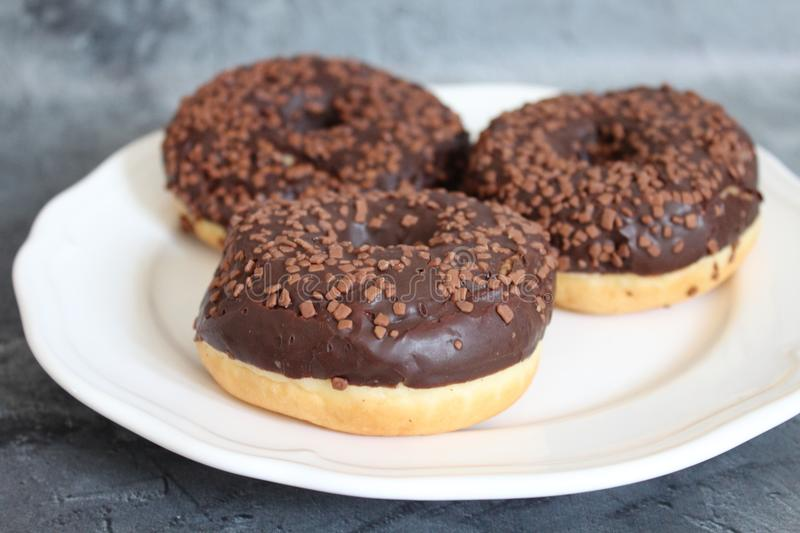 Donuts on a plate royalty free stock photos