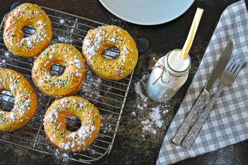 Donuts with powdered sugar and milk. colored soft donuts. stock photos