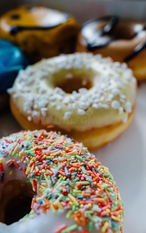 Donuts. Six colorful donuts with sprinkle and glaze. Close-up of donuts. Box of donuts royalty free stock photo