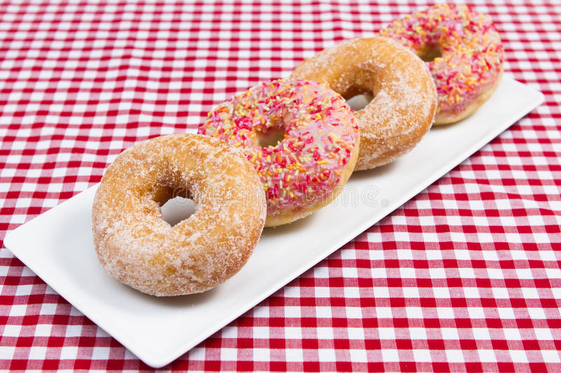 Donuts. A slate plate of assorted donuts royalty free stock photos